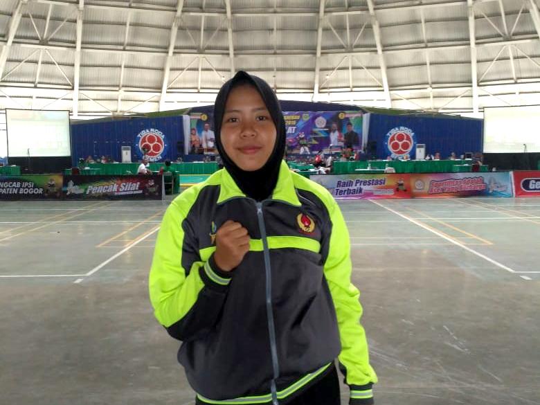 Mutia Atlet pencak silat yang turun pada nomor pertandingan putri